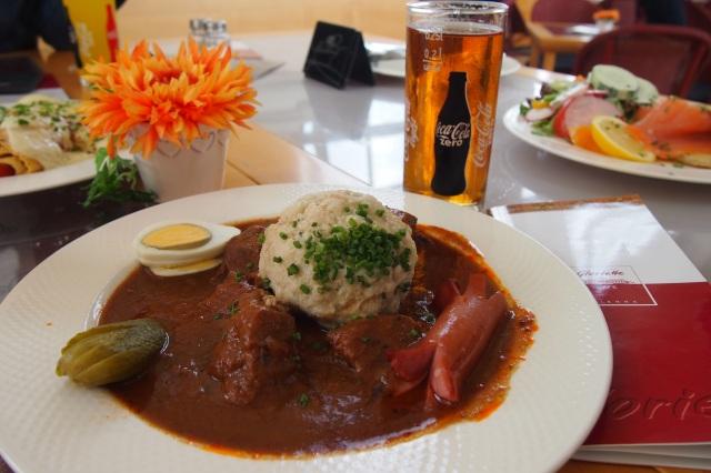 Herrengulasch mit Knodel, Wurstel und Ei. In plain English, beef goulash with dumpling and egg.