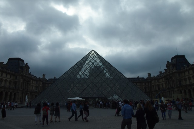 Grey skies greeted us but nothing can dull the beauty of the Louvre.