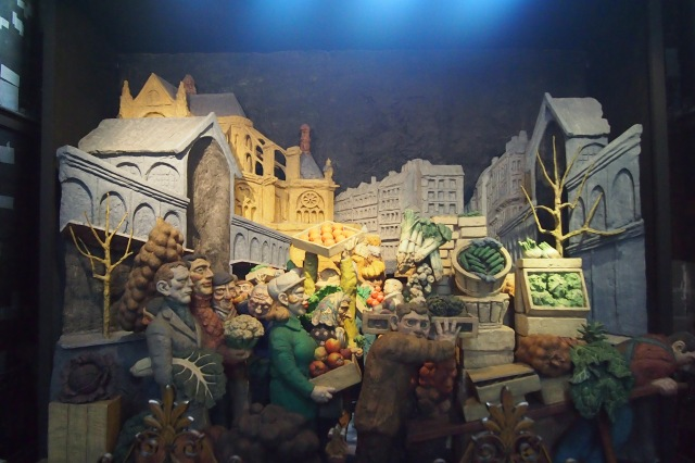 A diorama of farmers peddling their goods in the market.
